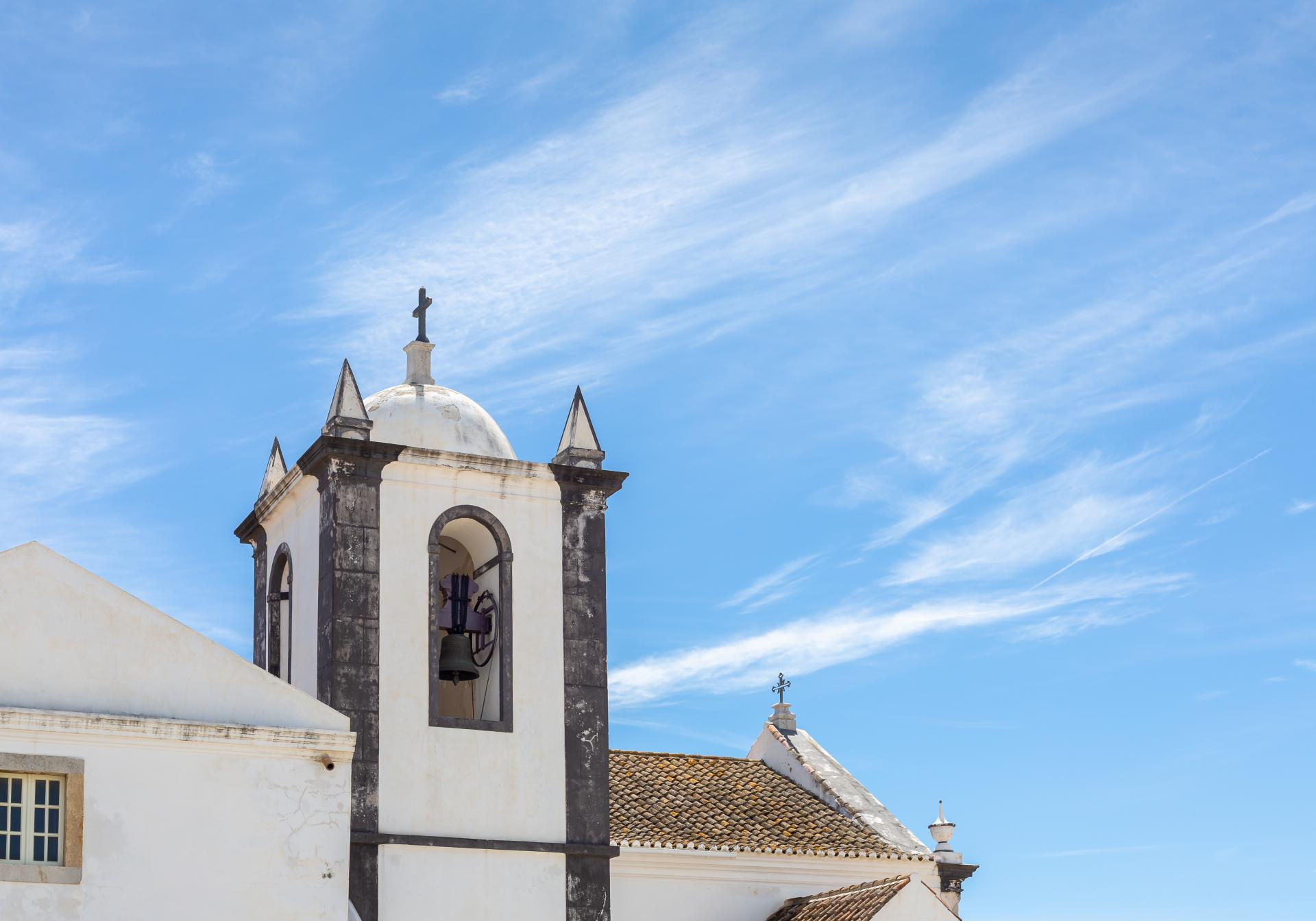 Taken at Cacela Velha, church bell tower against blue sky. Liane Ryan Photography