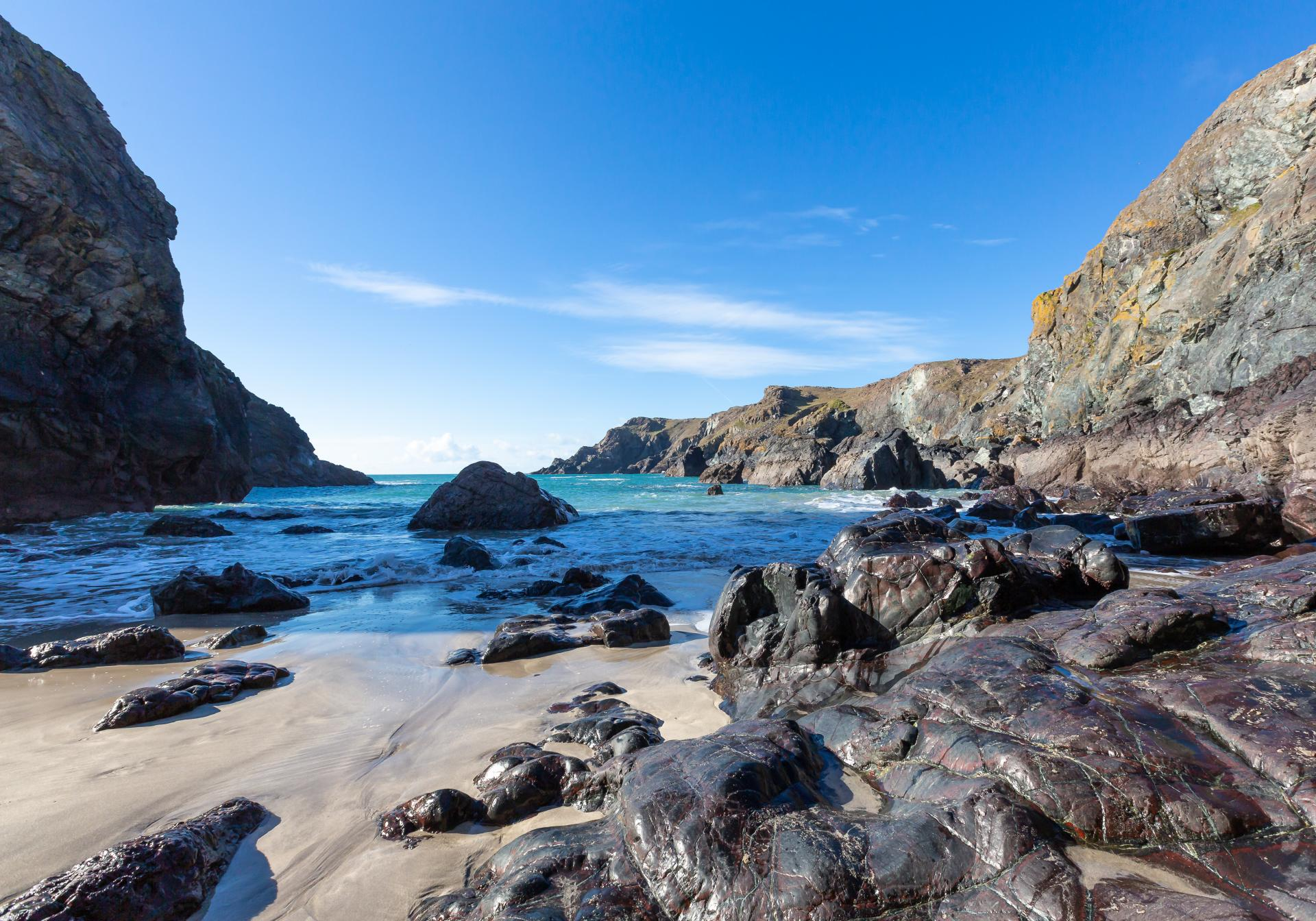 Kynance Cove at low tide taken from the shoreline looking out to sea, Liane Ryan Photography