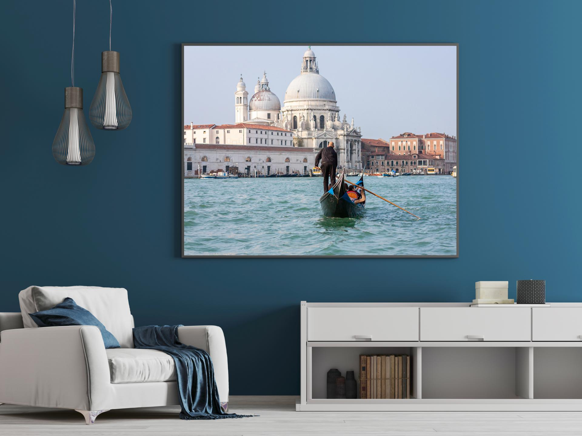 Gondola being rowed out in the water in Venice, bright colours, blue water. Liane Ryan Photography
